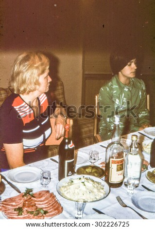 Vintage photo (scanned reversal film) of two woman during family dinner, early 1970's - stock photo