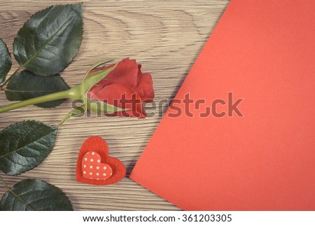 Vintage photo, Valentine red heart, rose and love letter in red envelope on wooden background, decoration for Valentines Day, symbol of love - stock photo