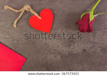 Vintage photo, Valentine red wooden heart, rose and love letter in red envelope on structure of concrete, decoration for Valentines Day, copy space for text - stock photo