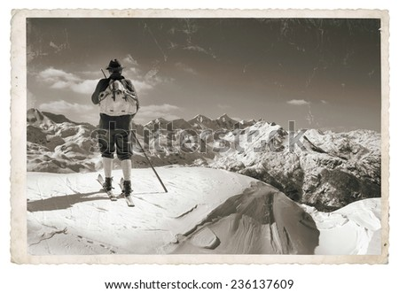 Vintage photo with old skier with traditional old wooden skis - stock photo