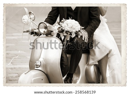 Vintage photo with Young newlywed just married, posing on an old gray scooter  - stock photo