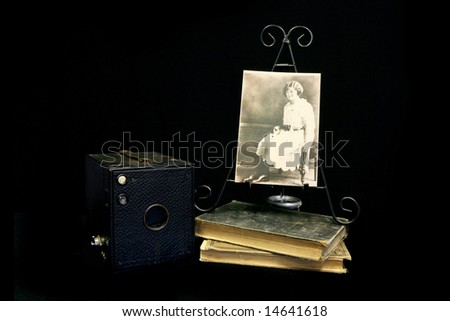Vintage Photograph Next to an Old Antique Pinhole Camera