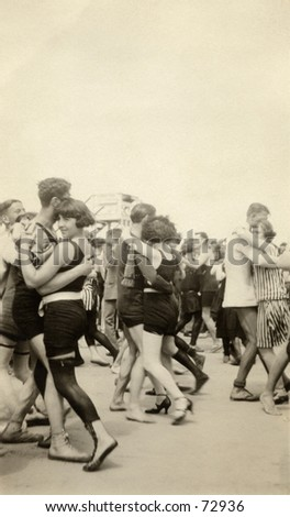 Vintage photograph of couples dancing in bathing costumes, circa 1900 - stock photo