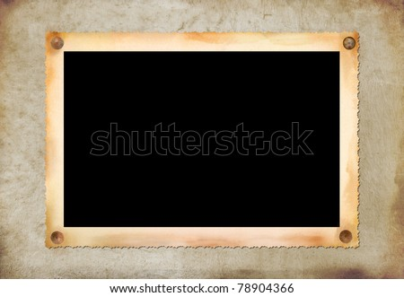 Vintage photographic blank picture frame om old paper texture - stock photo