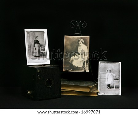 Vintage Photographs from 1910 era With Books and Vintage Pinhole Camera.