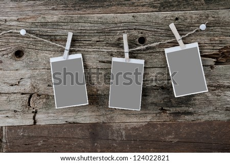 Vintage photos on stained wooden background. Place for your photos. - stock photo