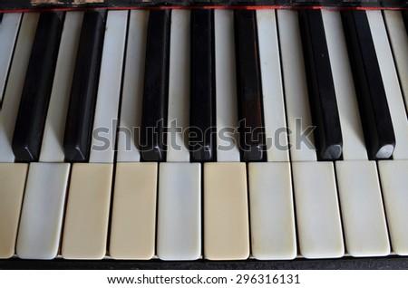 vintage piano keyboard with ivory keys  - stock photo