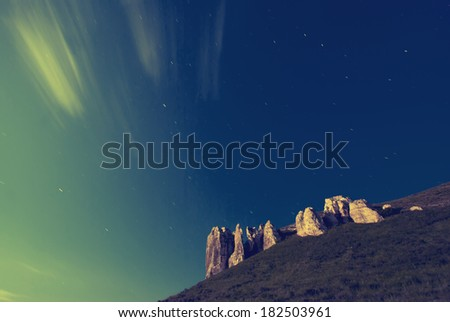 Vintage picture. Stars on the sky and moon rising over the mountains - stock photo