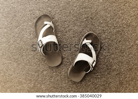 vintage picture tone. shoes on grass background - stock photo