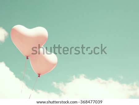 Vintage Pink balloons flying in a mint sky - stock photo