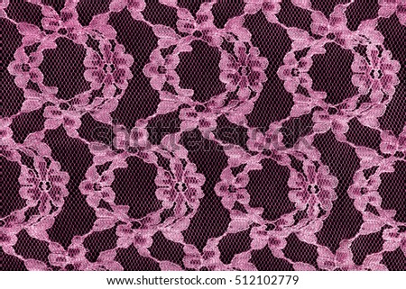 Vintage pink lace over black as a background