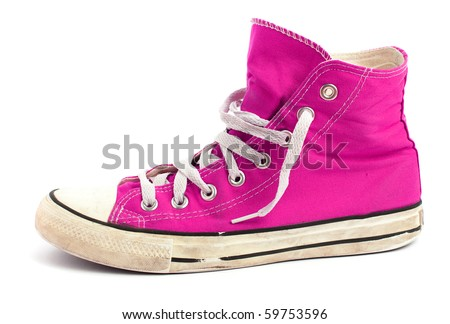 Vintage pink sneakers isolated on white background. - stock photo
