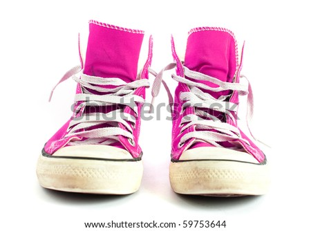 Vintage pink sneakers isolated on white background.