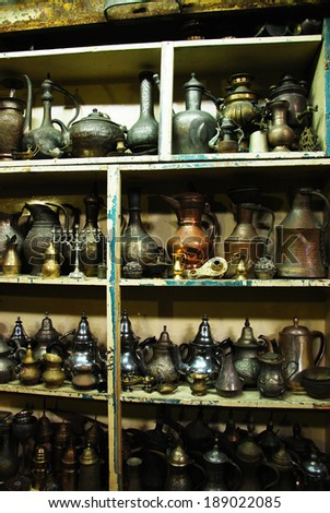 Vintage pitchers and lamps at a flea market - stock photo