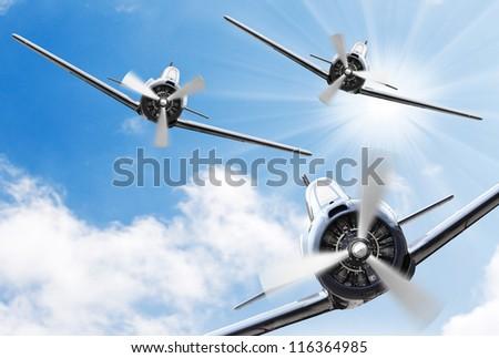 Vintage planes on a sunny sky. Retro technology background. - stock photo