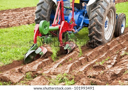 Vintage plows used to plow the field. - stock photo