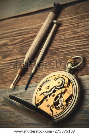 vintage pocket watch and a screwdriver. still life. instagram image retro style - stock photo