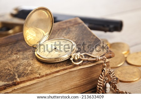 vintage pocket watch and golden coins