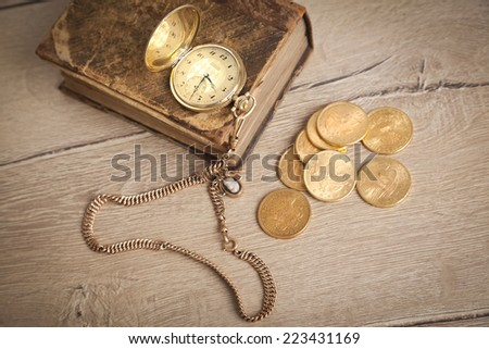 vintage pocket watch and golden us dollars - stock photo