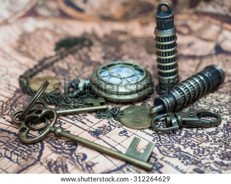 Vintage Pocket Watch And Retro Items On Ancient Map. - stock photo