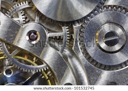 Vintage pocket watch inside gears macro detail. - stock photo