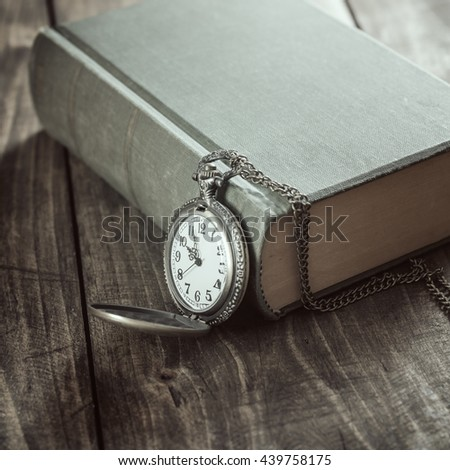 Vintage pocket watch on old books. Close up photo - stock photo