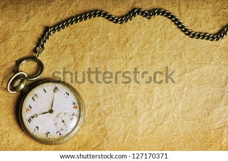 Vintage pocket watch on old paper - stock photo