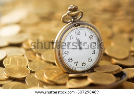 vintage pocket watch on the gold coins background