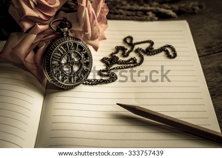 Vintage pocket watch pencil and roses on note book time concept,Vintage filter effect - stock photo