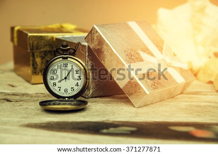 vintage pocket watch with gift box - stock photo