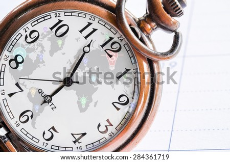 vintage pocket watch with globalization and dollar sign background on diary background. money, time and globalization concept. - stock photo