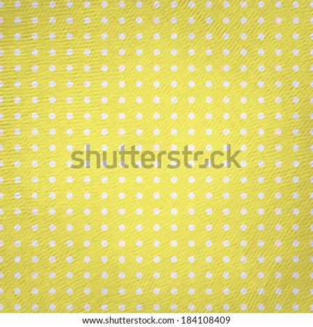 Vintage polka dot on yellow paper texture background.