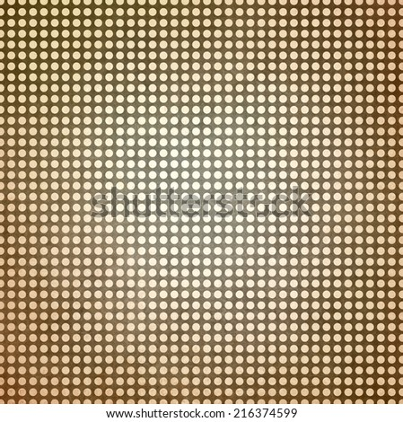 vintage polka dotted brown background, beige spots on brown paper with faint white center spot lighting - stock photo
