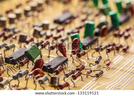 Vintage  populated printed circuit board - stock photo