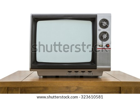 Vintage portable television and old wood table isolated on white - stock photo
