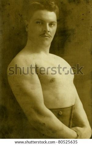 Vintage portrait of a artist circus. The shot was taken around 1914 year. - stock photo