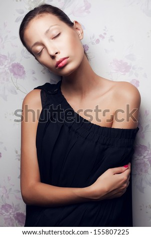 Vintage portrait of a glamorous dreaming retro girl posing in gorgeous classic dress . Hollywood style (film noir). Perfect skin and hairdo. Studio shot - stock photo