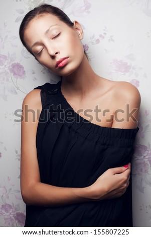 Vintage portrait of a glamorous dreaming retro girl posing in gorgeous classic dress . Hollywood style (film noir). Perfect skin and hairdo. Studio shot - stock photo