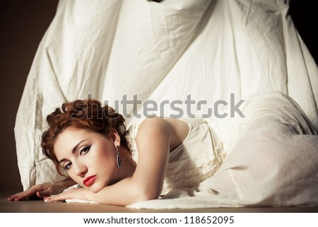 Vintage portrait of a glamourous queen like girl in bedroom. Retro style. Daylight. Studio shot - stock photo