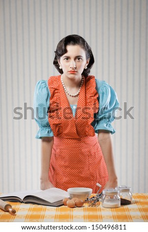 Vintage portrait of a housewife in the kitchen - stock photo