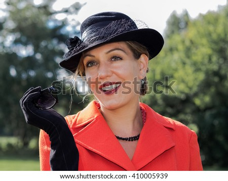 Vintage portrait of a smiling attractive woman styled old fashion. - stock photo