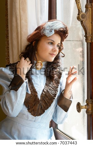 """Vintage portrait of a victorian lady standing by a castle window. Shot in the antique castle """"Den Brandt"""" in Antwerp, Belgium (with signed property release for the Castle interiors). - stock photo"""