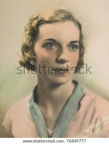 Vintage portrait of a woman on textured paper with a handwritten note to a loved one. - stock photo