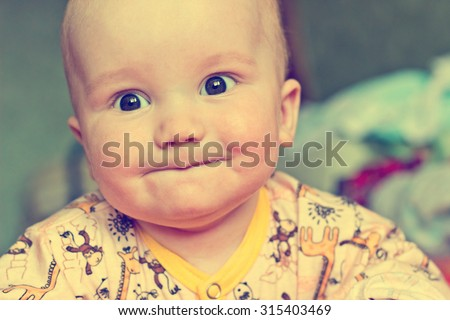 Vintage portrait of adorable serious baby boy - stock photo