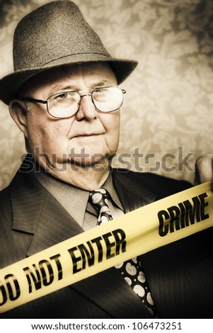 Vintage portrait of an elderly perceptive crime detective with an observant look in his eye watching carefully as he stands behind the tape at a crime scene - stock photo