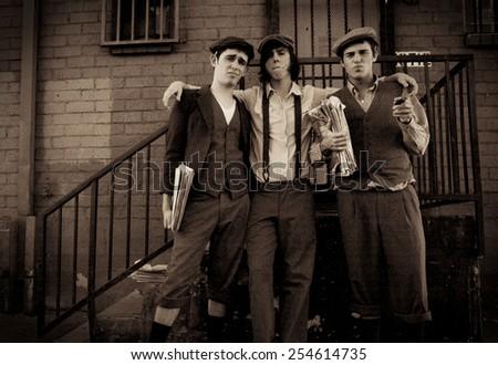 Vintage Portrait of Newspaper Boys - stock photo