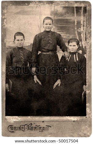 Vintage portrait of siblings three a sister,1912 year. - stock photo