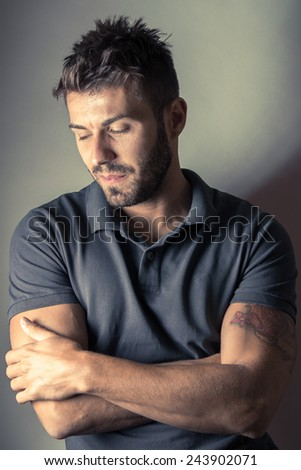 Vintage portrait of young happy man in polo shirt  - stock photo