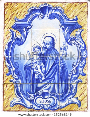 vintage portuguese tiles with Saint Joseph - stock photo