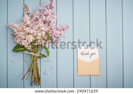 vintage postage envelope with card thank you and beautiful summer blooming bouquet of lilac - stock photo